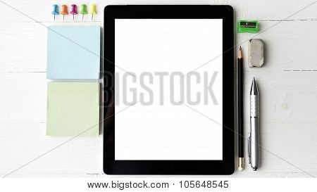 Tablet With Office Supplies