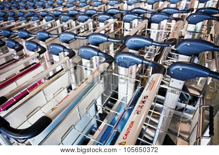 Row of luggage carts in the airport