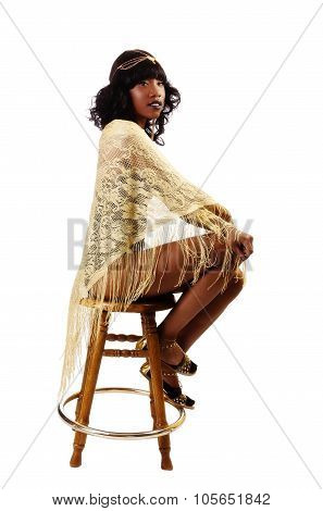 Skinny African American Woman Sitting Gold Shawl