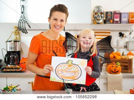 Girl With Mother Showing Halloween Jack-o-lantern Drawing