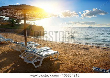 Chaise-longues on a beach
