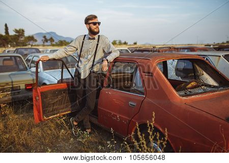 Young Handsome Stylish Man, Wearing Shirt And Bow-tie With Old Cars