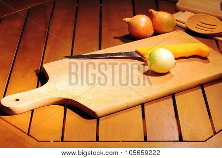 onion on cutting board on a wooden table cutting board