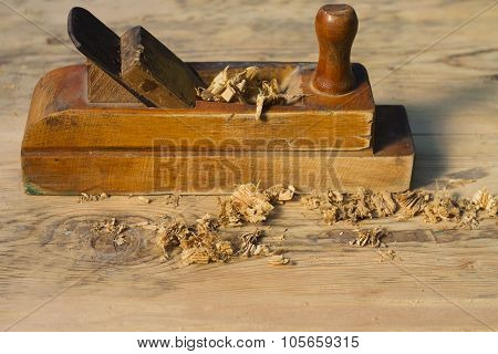 Old  Jack-plane  With Wood Shavings On A Wooden Surface