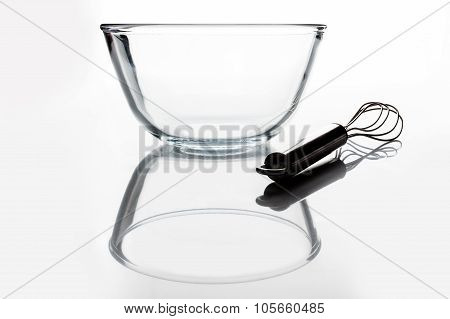 Glass bowl with whisker from side with reflection