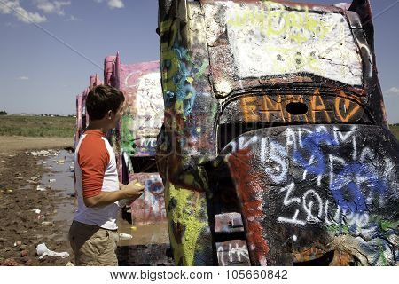 Teenager At Cadillac Ranch