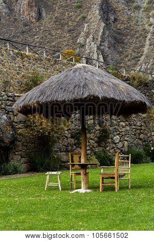 Thatched Umbrella Wooden Table And Chairs Resort