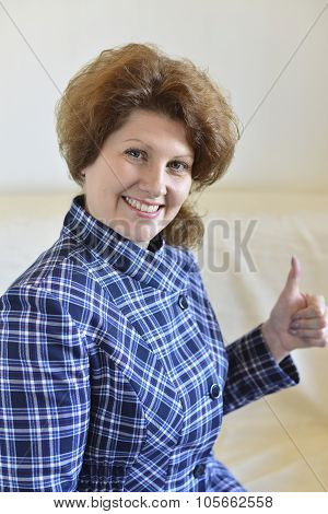 woman shows a gesture that all is well