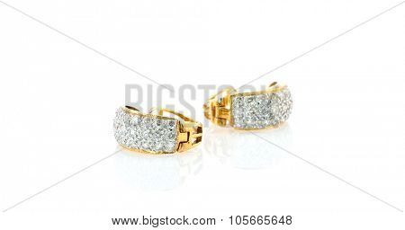 Diamond ear rings isolated on white background.