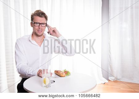 Young Business Man Has An Unpleasant Phone Call During Lunch Break