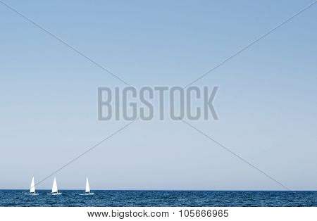 Three Sailsboat On Sea On Sunny Summer Day