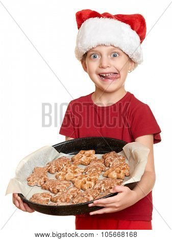 girl in santa hat eat cookies and lick oneself - winter holiday christmas concept
