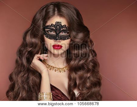 Wavy Hair. Beautiful Brunette Girl. Makeup. Red Lips. Fashion Lady Wearing Venetian Masquerade Carni