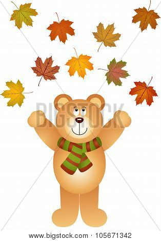 Teddy bear catcing fall leaves