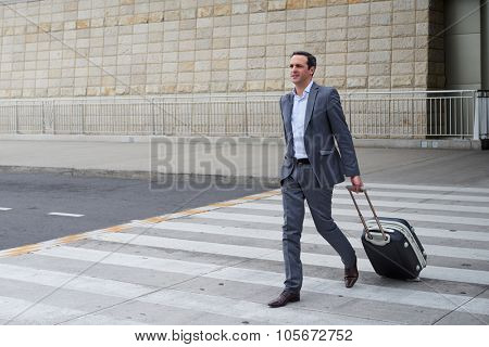 Business man walking at the airport