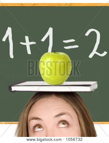 Female Student Over A Blackboard