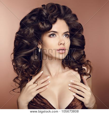 Wavy Healthy Hair. Beauty Brunette Girl Model With Elegant Hairstyle. Luxury Fashion Style, Manicure