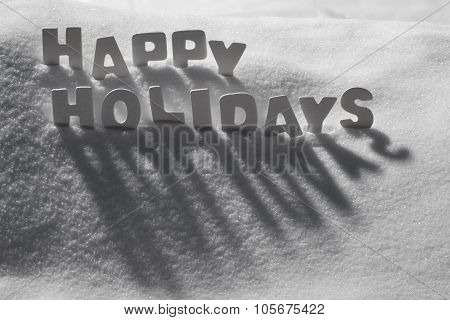 Christmas Card With White Word Happy Holidays On Snow