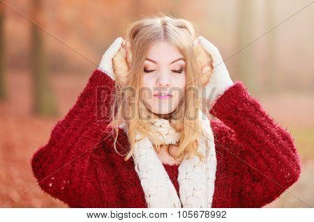 Portrait Of Pretty Relaxed Woman In Earmuffs.