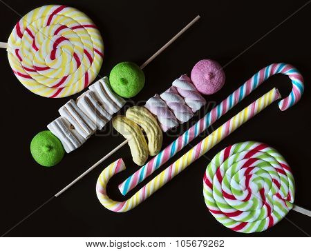 Background with bonbons and lolipops