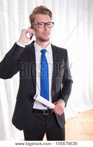 Smart Young Business Man In Suit And Tie On The Phone