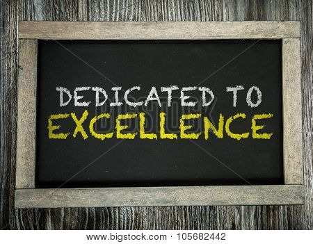 Dedicated to Excellence written on chalkboard