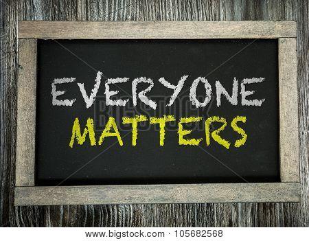 Everyone Matters written on chalkboard
