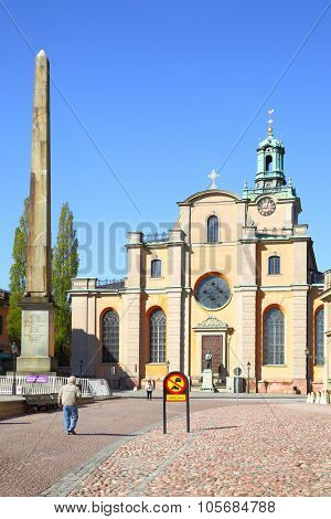 STOCKHOLM, SWEDEN - May 21, 2015: Stele and Cathedral of Saint Nicholas in Stockholm