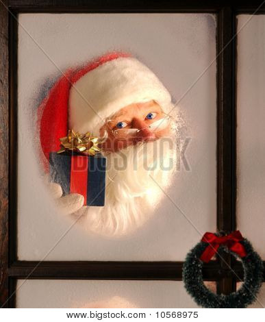 Papai Noel na janela com presente
