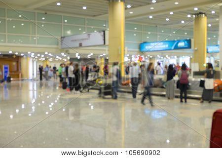 Blur focus of people waiting luggage at Baggage claim.