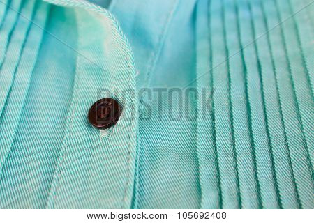 Brown buttons on blue fabric
