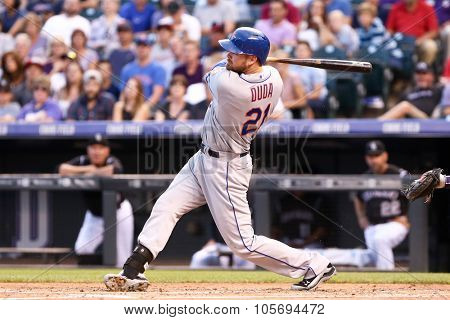 DENVER-AUG 21: New York Mets infielder Lucas Duda swings a pitch during a game against the Colorado Rockies at Coors Field on August 21, 2015 in Denver, Colorado.