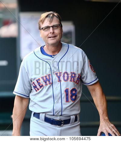 DENVER-AUG 21: New York Mets coach Tim Teufel in the dugout before a game against the Colorado Rockies at Coors Field on August 21, 2015 in Denver, Colorado.