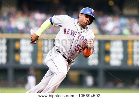 DENVER-AUG 21: New York Mets outfielder Yoenis Cespedes rounds third base during a game against the Colorado Rockies at Coors Field on August 21, 2015 in Denver, Colorado.
