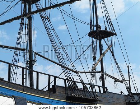 Masts And Rigging Of A Old Sailing Ship Over Blue Sky