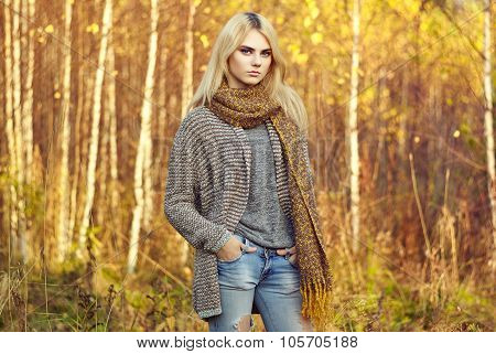 Portrait Of Young Beautiful Woman In Autumn Pullover