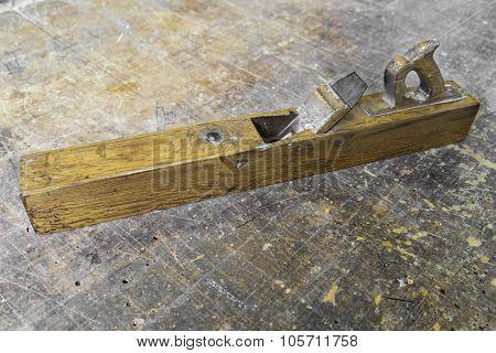 Old Carpenter Tool Planer On Vintage Wooden Background