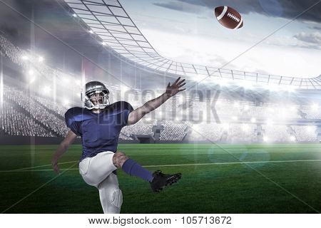 American football player kicking against rugby stadium