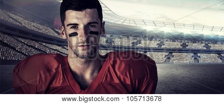 Portrait of focused rugby player against rugby stadium