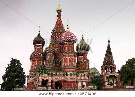 Saint Basil's Cathedral in focus between two trees.