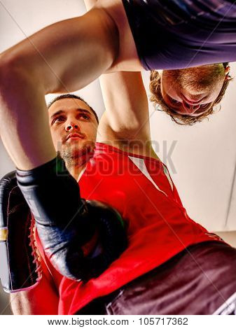 Two  men boxer wearing  sport gloves boxing .Bottom view.