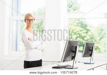 Beautiful female ceo being confident in the office.