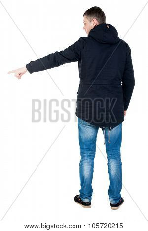 Back view of pointing man in winter jacket  looking up.   Standing young guy in parka. Rear view people collection.  backside view of person.  Isolated over white background.