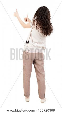 Back view of  woman thumbs up. Rear view people collection. backside view of person. Isolated over white background. A girl with curly hair showing thumbs up with both hands.
