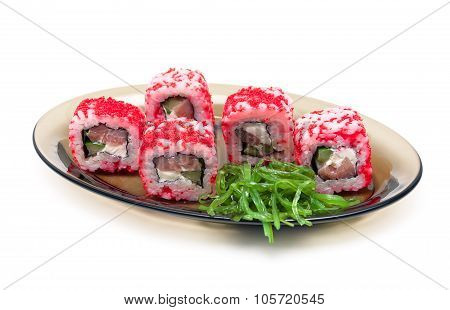 Japanese Rolls With Red Caviar And Chuka Salad On A Plate On A White Background