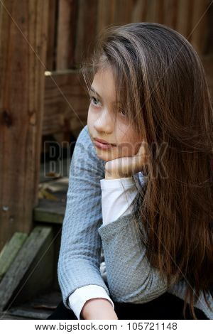 Beautiful Young Girl Sitting On Steps