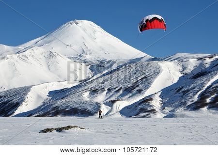 Kiteboarding - Sportsman Glides On Skis On Background Volcano