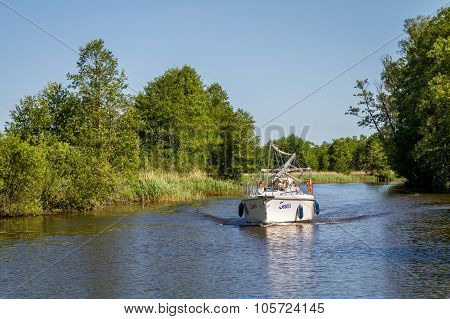 Motor boat floats on the Elblag Canal