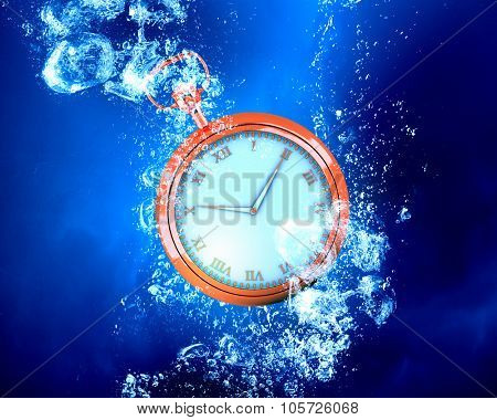 Pocket watch sink in clear blue water