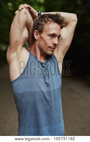 Muscular Man Doing Stretching Exercises